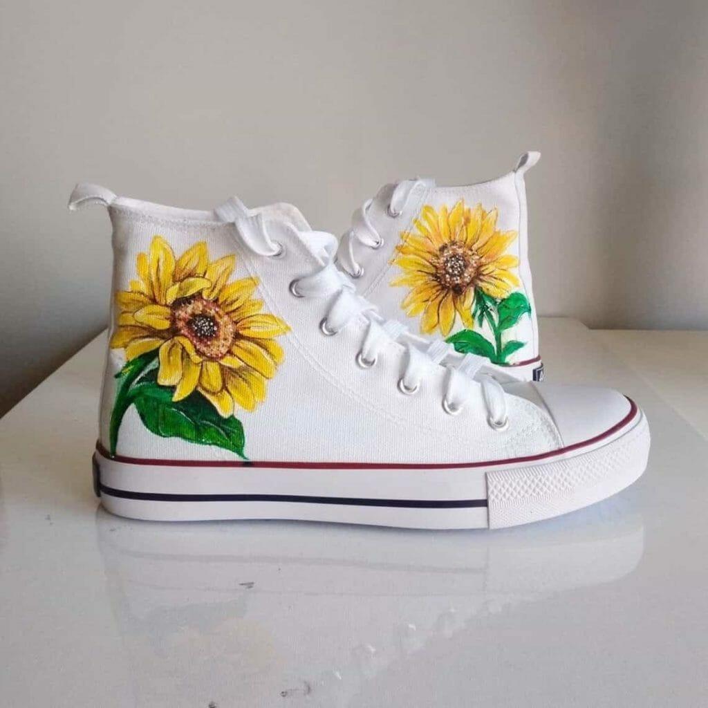 Hand painted sunflower on white Converse Chucks (All Stars)